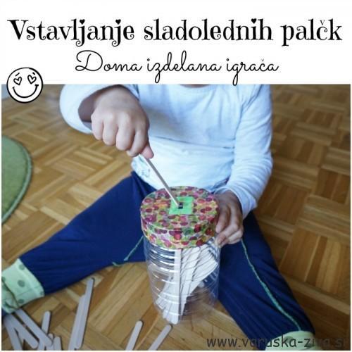 Vstavljanje palčk v posodico - doma izdelane igrače - koordinacija roka oko